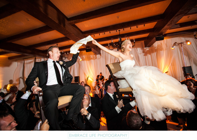 Couple Lifted High During The Hora