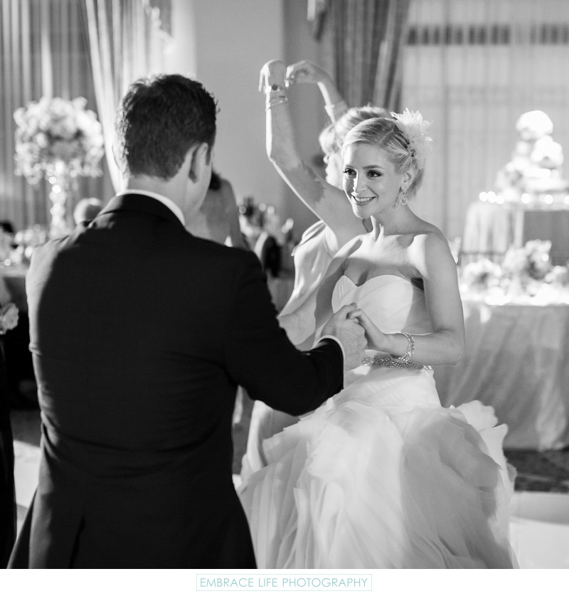 Smiling Bride Dancing in Ballroom
