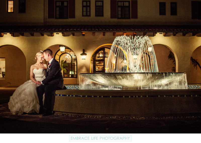 Wedding Couple Sit By Beautiful Garden Fountain