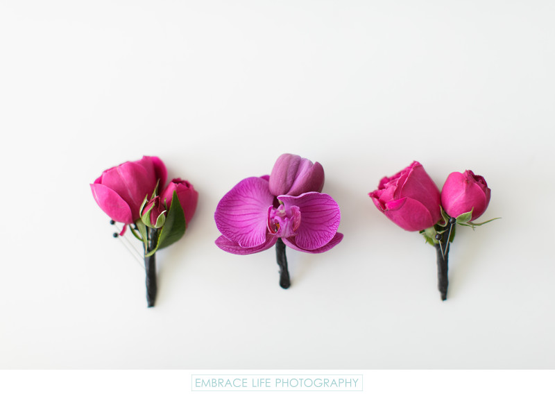 Purple Orchid and Fuchsia Rose Boutonnieres