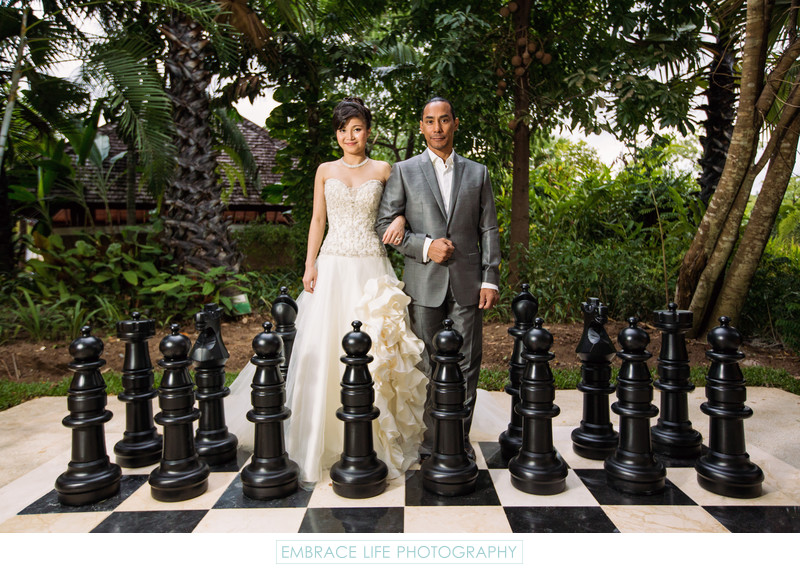 Couple Outside With Giant Chess Pieces