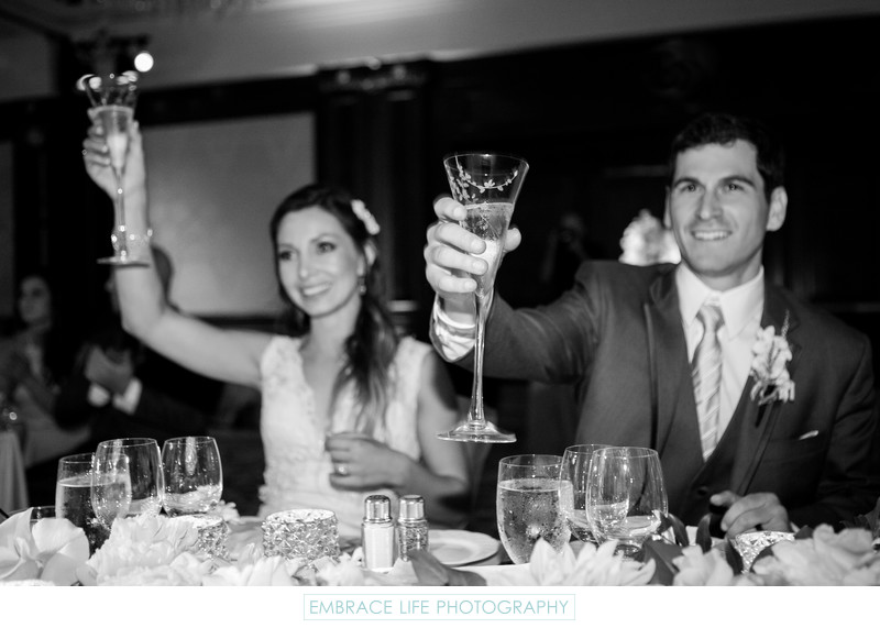 Bride and Groom Sharing in a Toast
