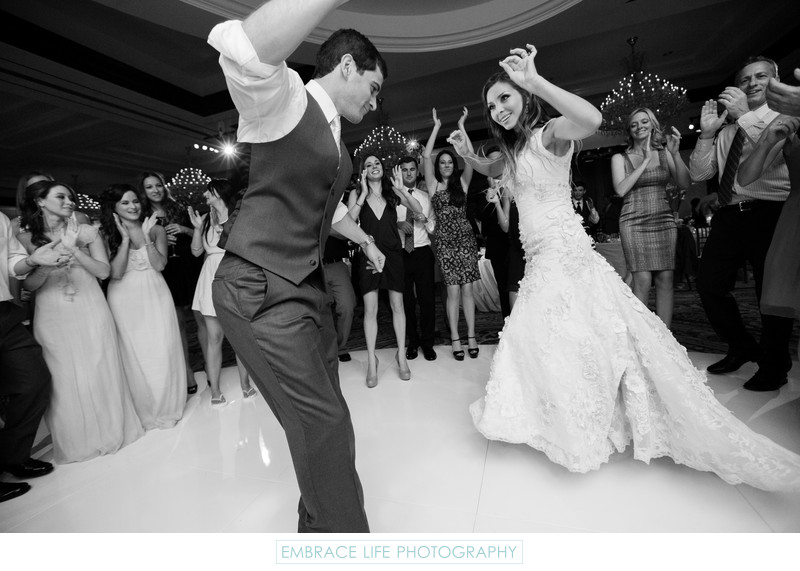 Bride and Groom on their Round White Dancefloor