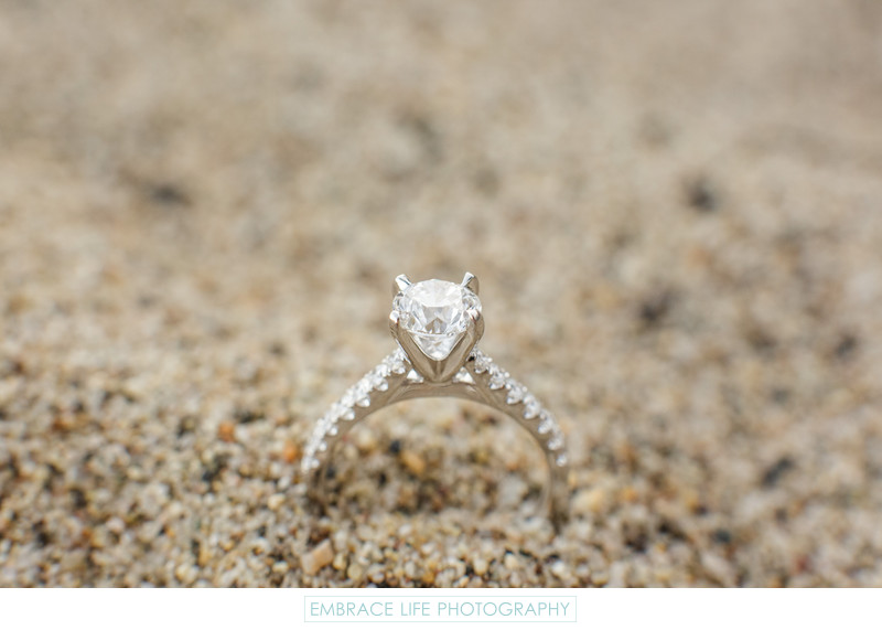 Wedding Engagement Ring in the Sand at Paradise Cove