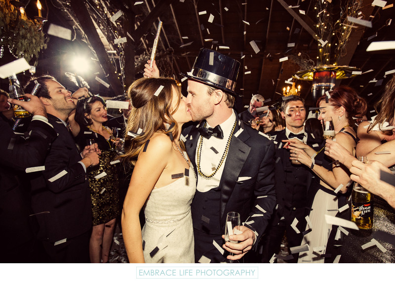 New years eve wedding couple kissing among confetti reception new years eve wedding couple kissing among confetti junglespirit Choice Image