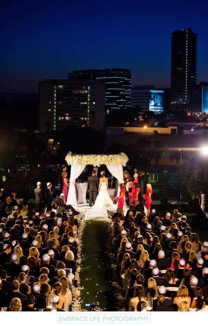 Night Time Wedding Ceremony with City Skyline View