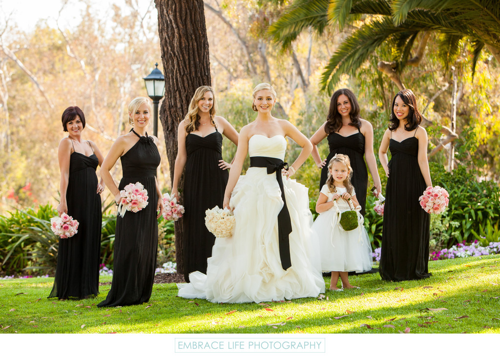 Bride Posing With Bridesmaids and Flower girl