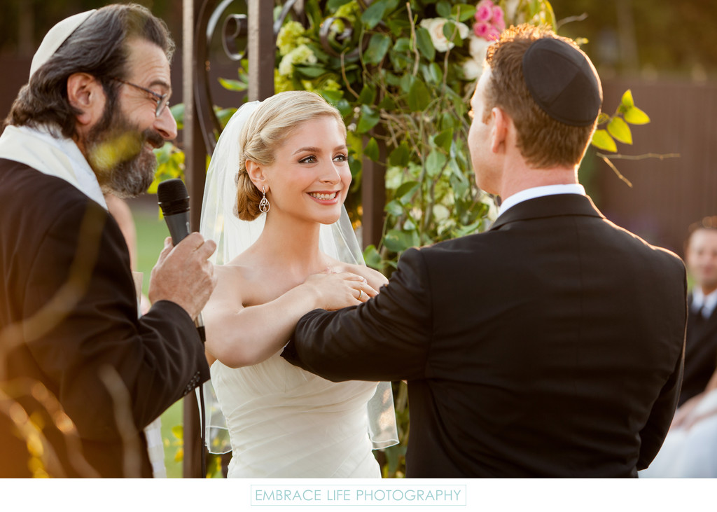 Rabbi and Wedding Couple at Ceremony