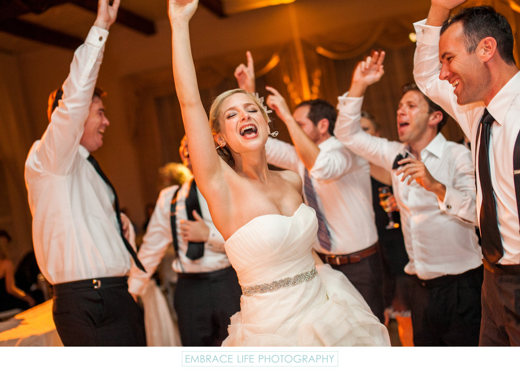 Laughing Bride Dances With Men