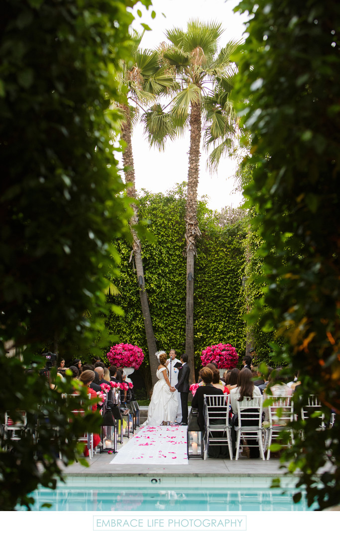 Garden Shot of Couples Saying Their Vows
