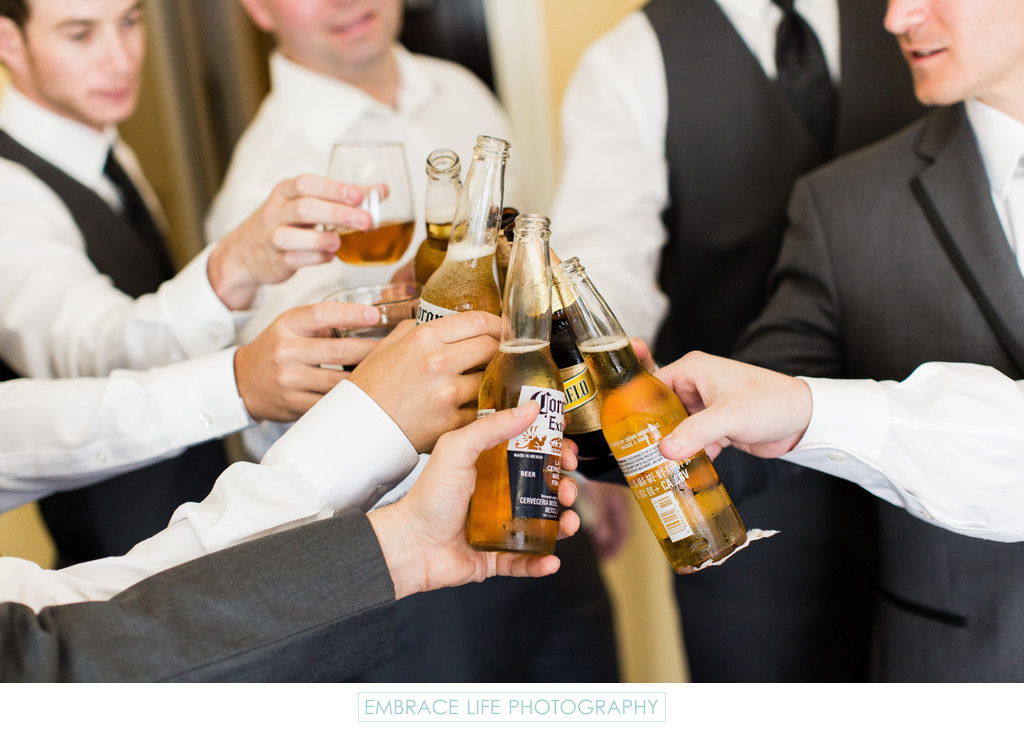 Groomsmen Toasting Beers Before Ceremony