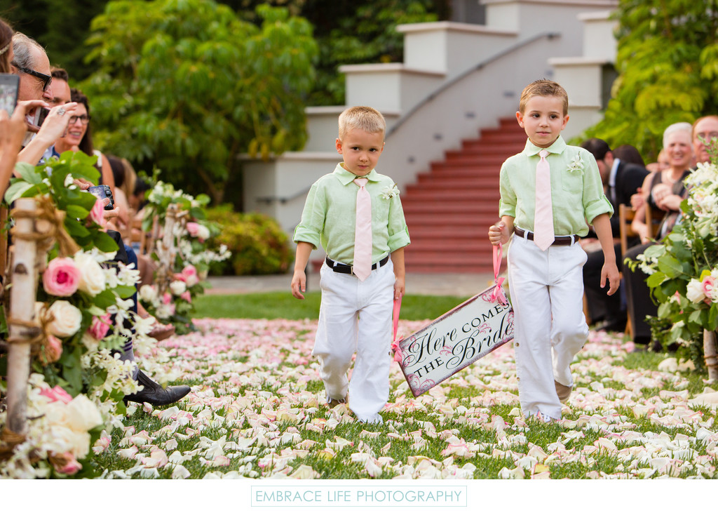 Ring Bearers Holding Rustic Here Comes the Bride Sign