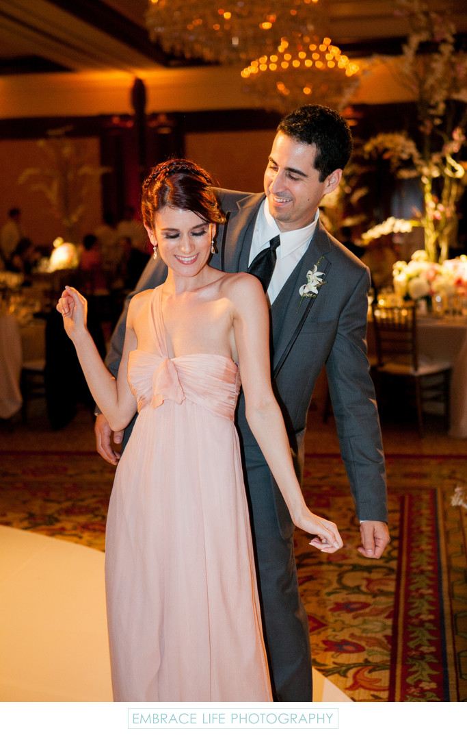 Handsome Groomsman and Beautiful Bridesmaid Dancing