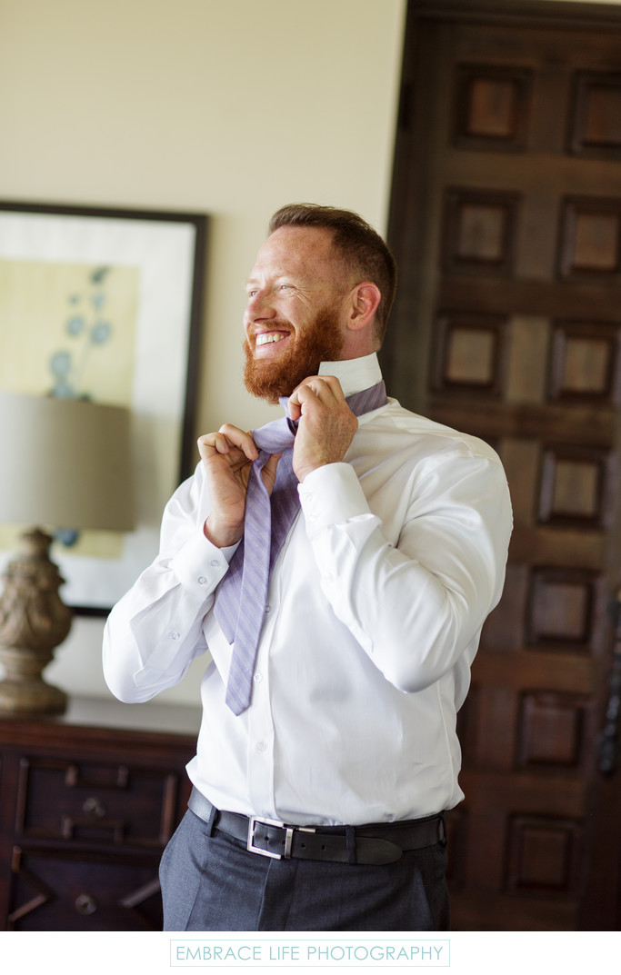 Groom Getting Ready for His Wedding With Lavender Tie
