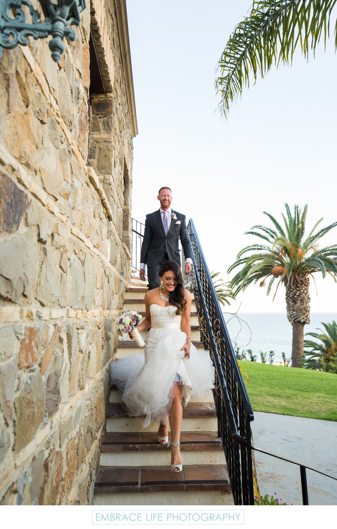 Bride & Groom on Staircase of an Elegant Wedding Venue