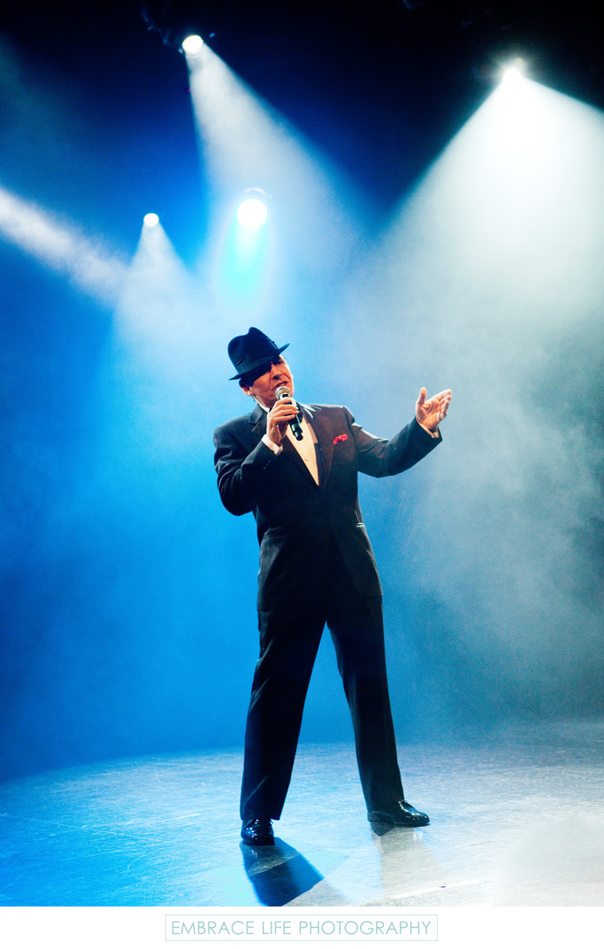 Frank Sinatra Impersonator Singing Under Stage Lighting