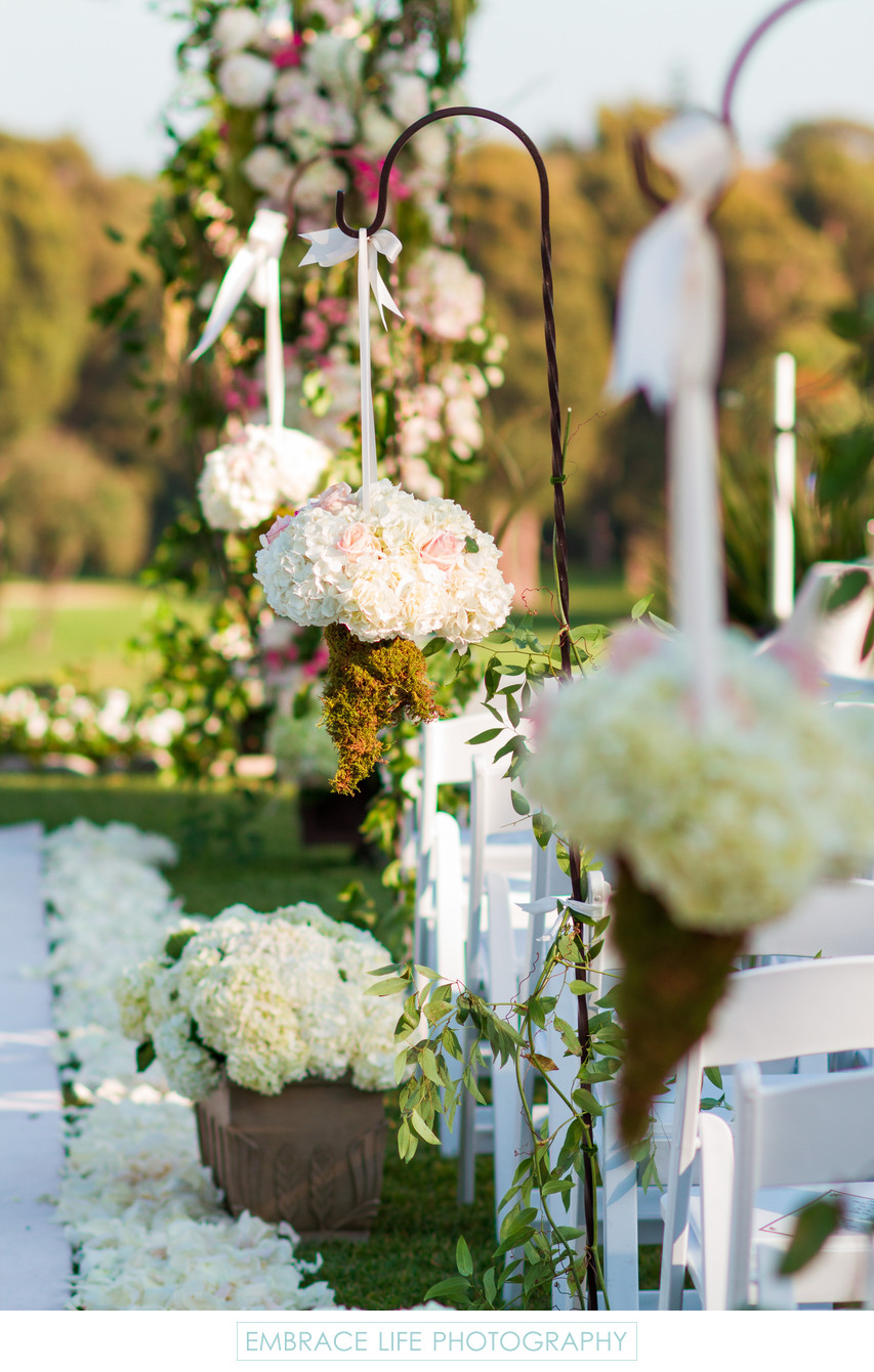 Hanging Floral Bouquets Lining Wedding Aisle