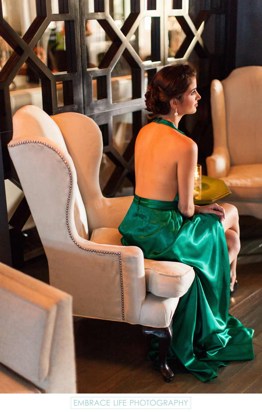 Fashionable Wedding Guest in Emerald Satin Gown
