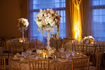 Tall Crystal Candelabra Vases Hold Rose Centerpiece