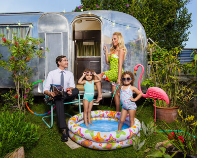 Airstream Family Portrait With Pink Flamingo and Pool