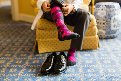 Groom Putting on Pink Argyle Socks