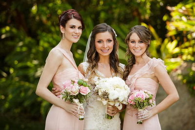 Bridesmaids Hold Bohemian Bouquets