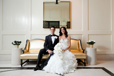Bride and Groom Portrait in Modern Hotel on Gold Couch