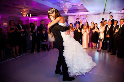 Groom Lifts Bride During First Dance as Husband & Wife