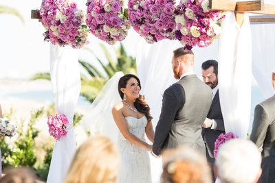 Exchanging Wedding Vows Under Lavender Rose Canopy
