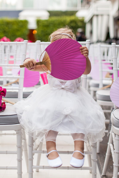 Flower Girl Hides Behind Large Hand Fan