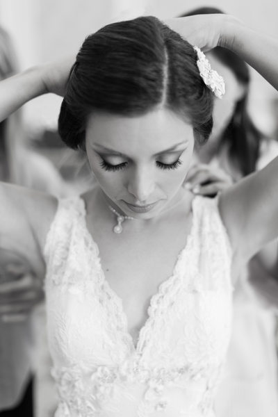 Bride Putting on Wedding Jewelry