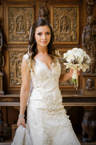 Lovely Bride Holding White Bouquet