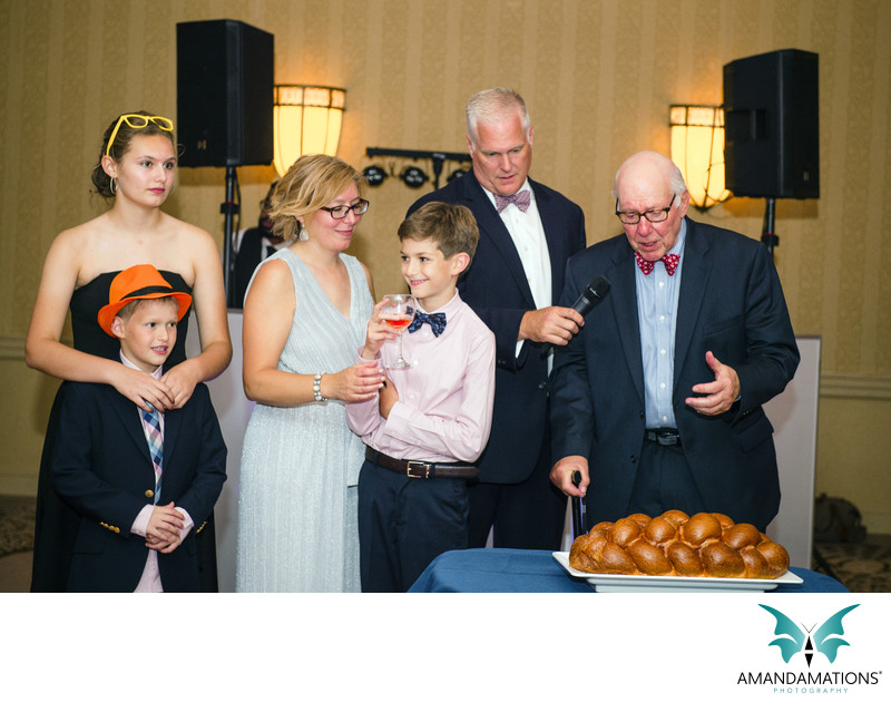 Bar Mitzvah Family Cutting the Challah