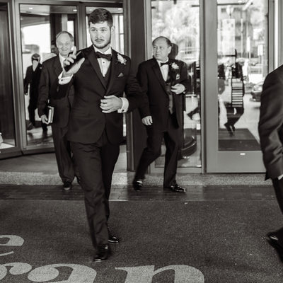A Groom Leaves The Logan Hotel In Philadelphia, PA