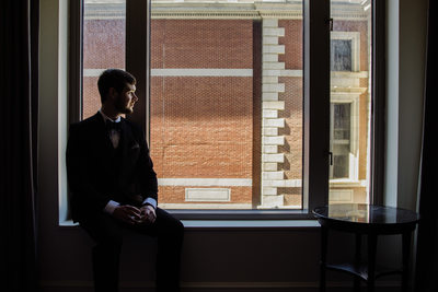 Groom Sits At The Logan Hotel In Philadelphia