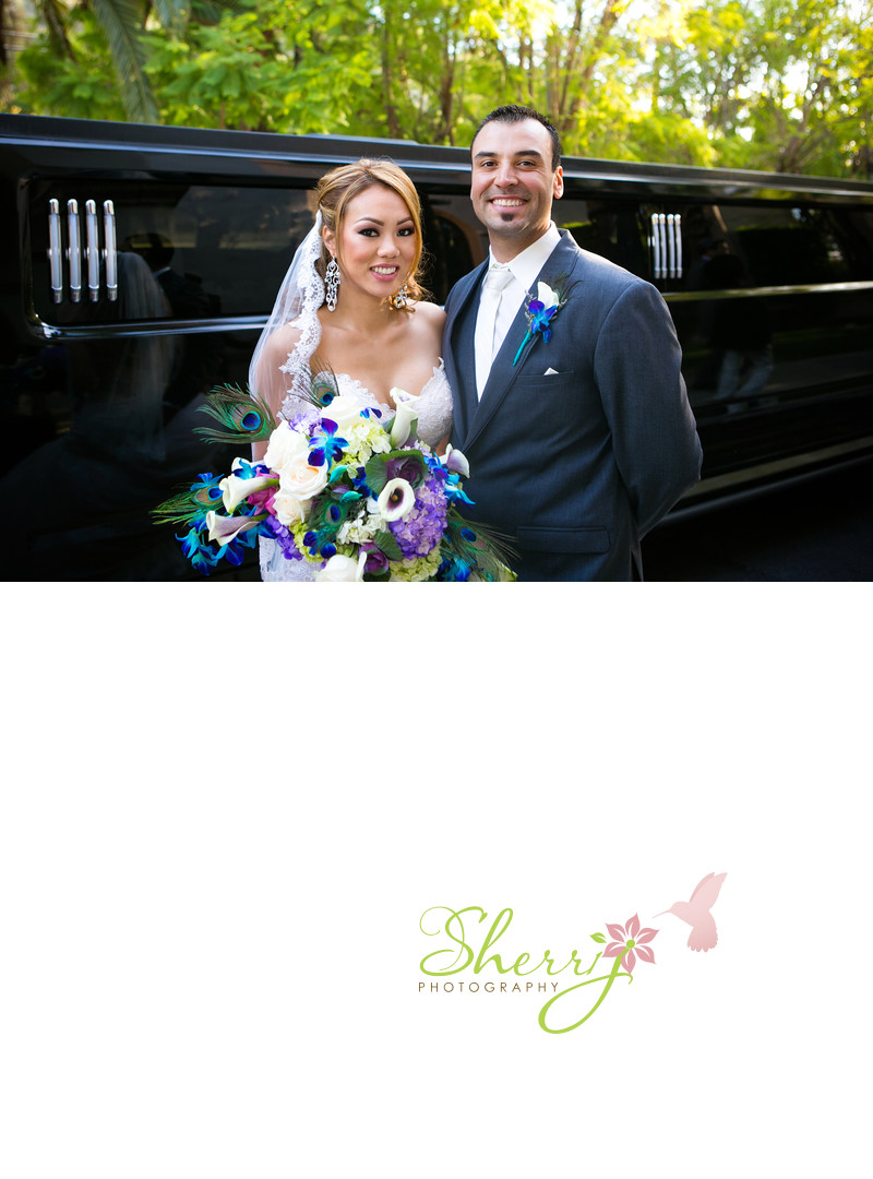 bride and groom with hummer limo