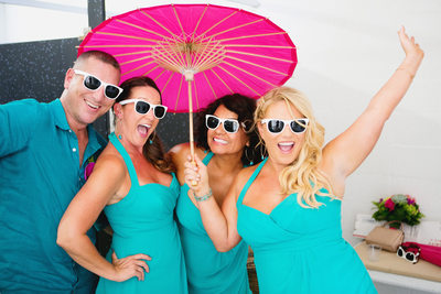 teal bridal party pink umbrella