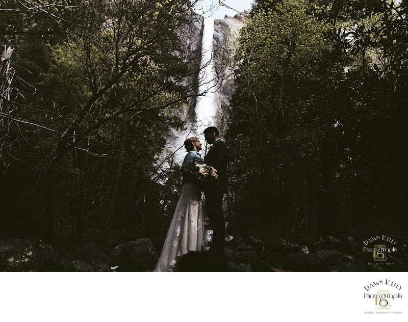 Bride and groom with Bridal Veil Falls Yosemite
