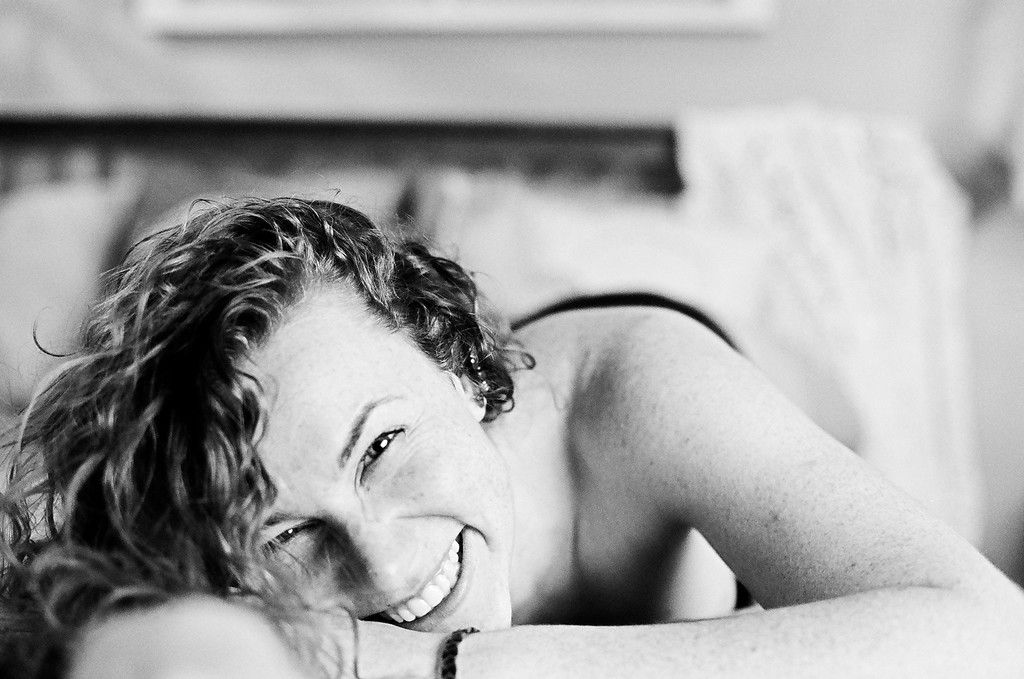 laughing boudoir portrait