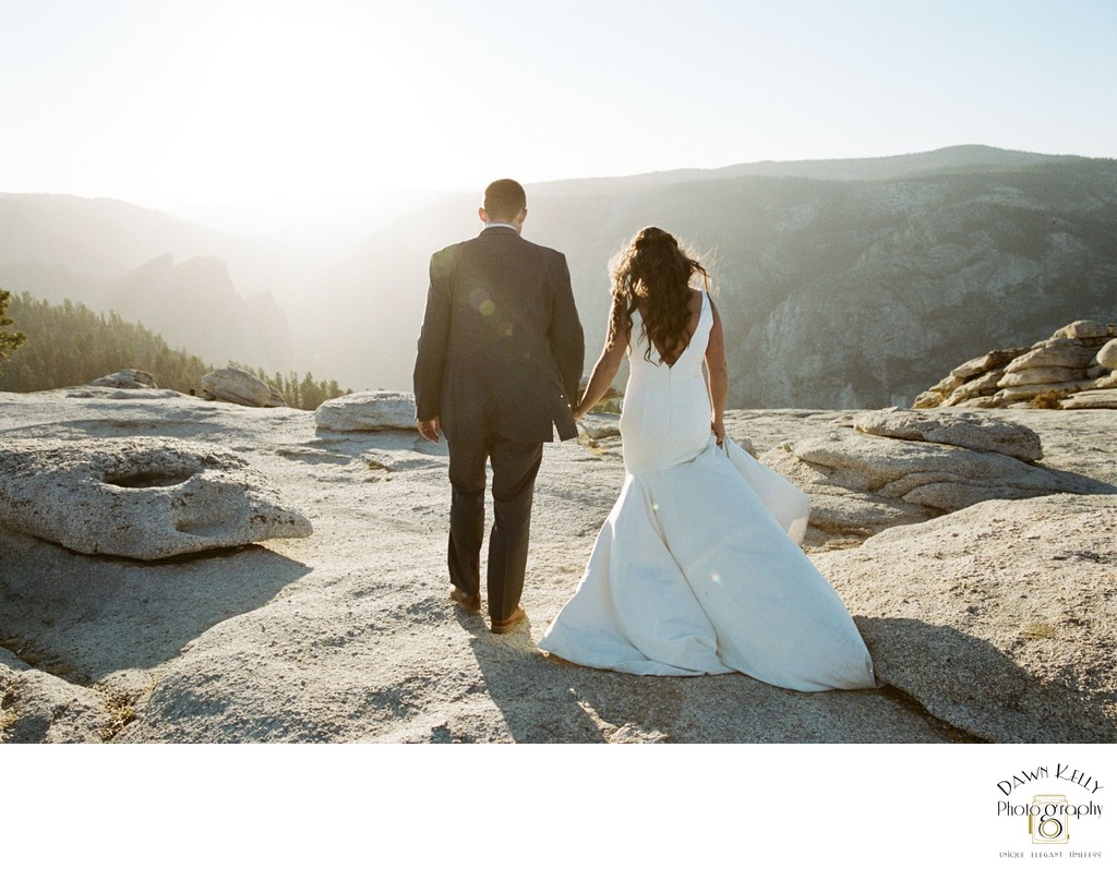 Yosemite elopement bride and groom walking away from camera