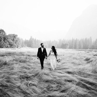 Yosemite elopement walking through meadow