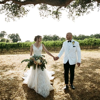 Bride and groom walking at Rancho Victoria Vineyards