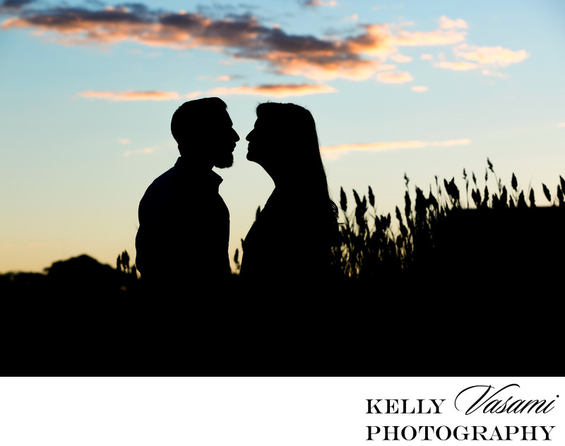 Silhouette Sunset Engagement Session in a field