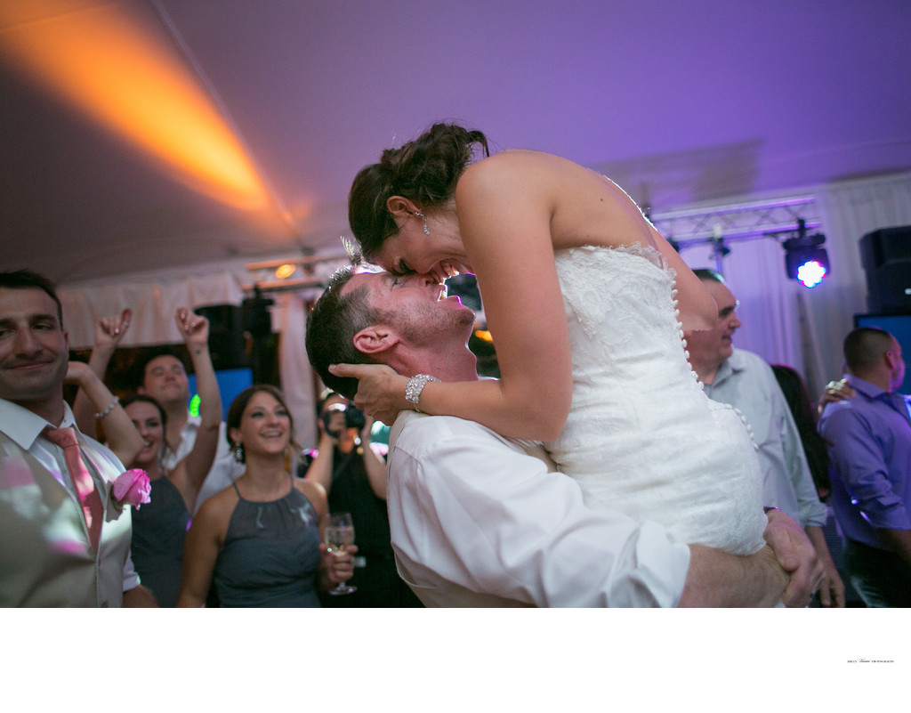 Bride and Groom dance at reception | purple uplighting