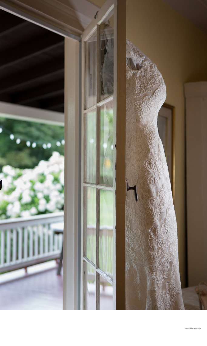 Bridal Gown hanging in Doorway | Farmhouse Wedding