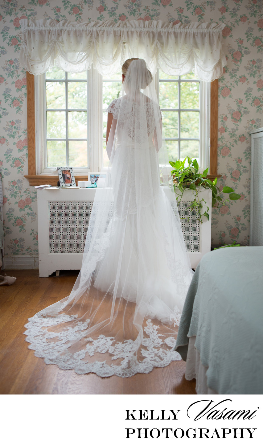 Full length bride looking out window | Westchester NY