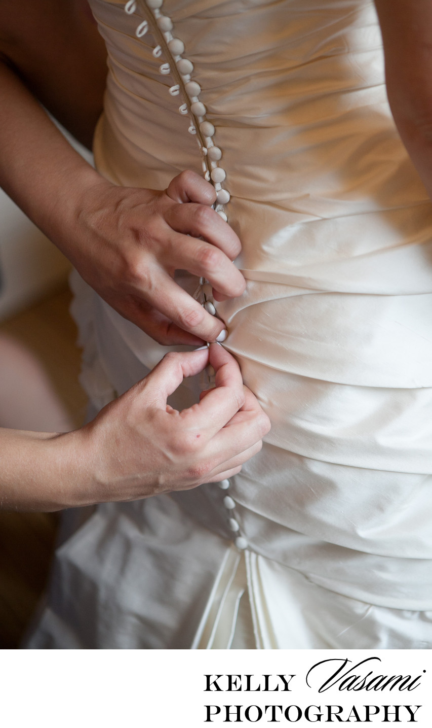Buttoning Up The Bride's Wedding Gown | White Plains