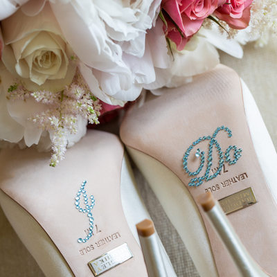 badgley mischka white wedding shoes and flowers