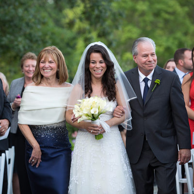 bride escorted up aisle by parents mamaroneck wedding