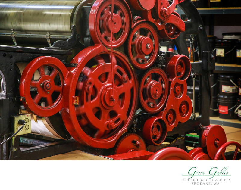 moving gears of a printing press